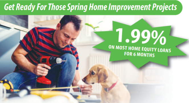 spring home improvement photo of man working with drill while dog looks on
